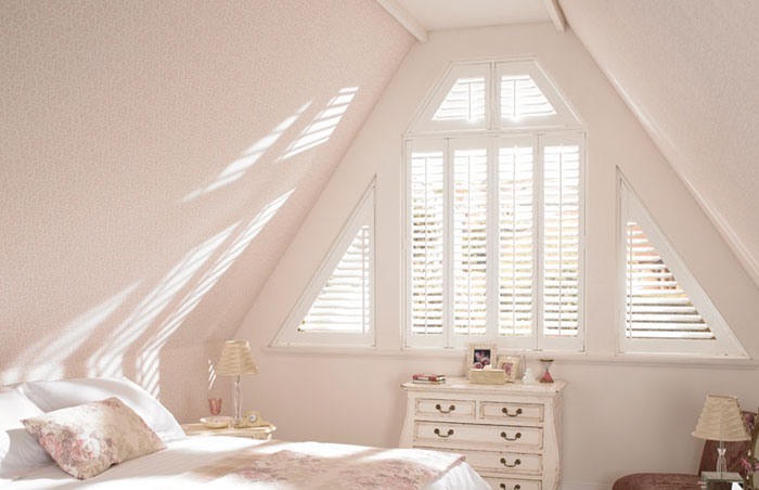 Angled Grovewood Shutters in Silk White